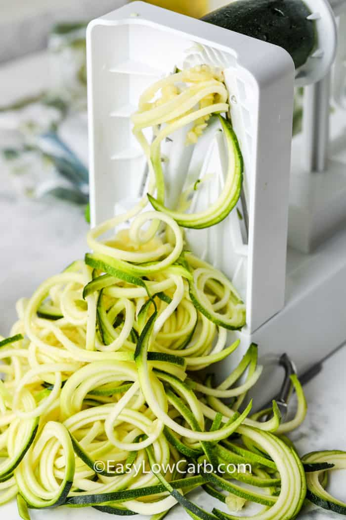 making zucchini noodles to make Zucchini Pasta Salad