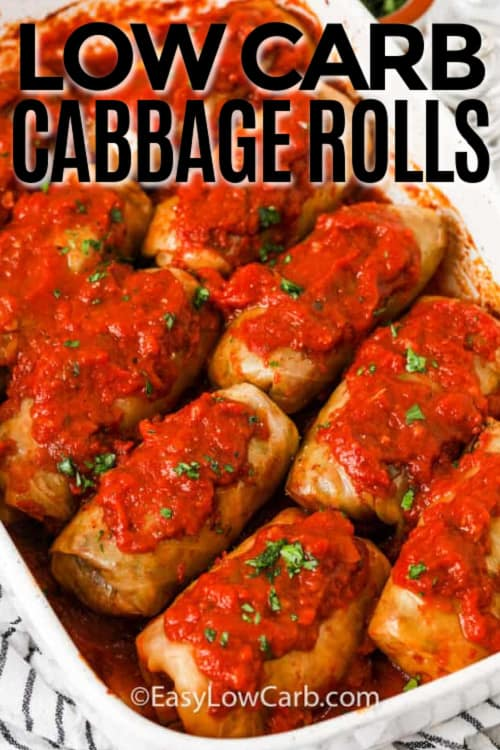 Baked Cabbage Rolls with tomato sauce in a white baking dish, with a title.