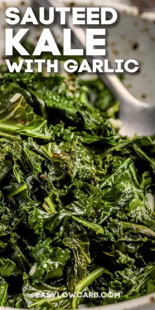 sauteed kale and garlic in a bowl with a silver spoon and a title