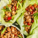 Chicken Lettuce Wraps with a bowl of filling on the side, with a title