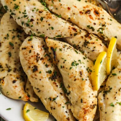 Low Carb Chicken Tenders on a plate with lemon slices