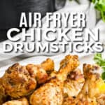 plated Air Fryer Drumsticks with air fryer in the back with a title