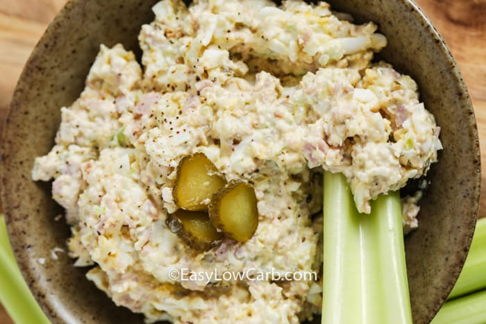Deviled Ham & Egg Salad in a bowl with celery and pickles