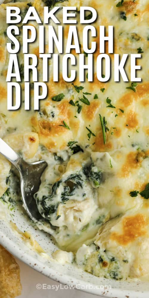 cooked Baked Spinach Artichoke Dip with a spoon and writing