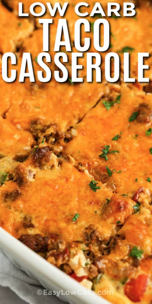 Low Carb Taco Casserole in the dish sliced with a title