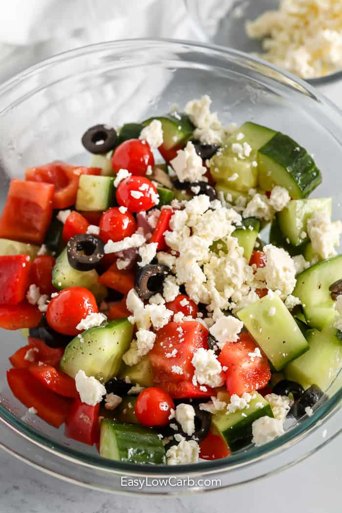 greek salad in a bowl with feta cheese