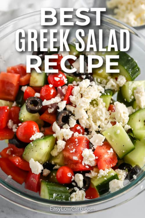 greek salad in a glass bowl with text