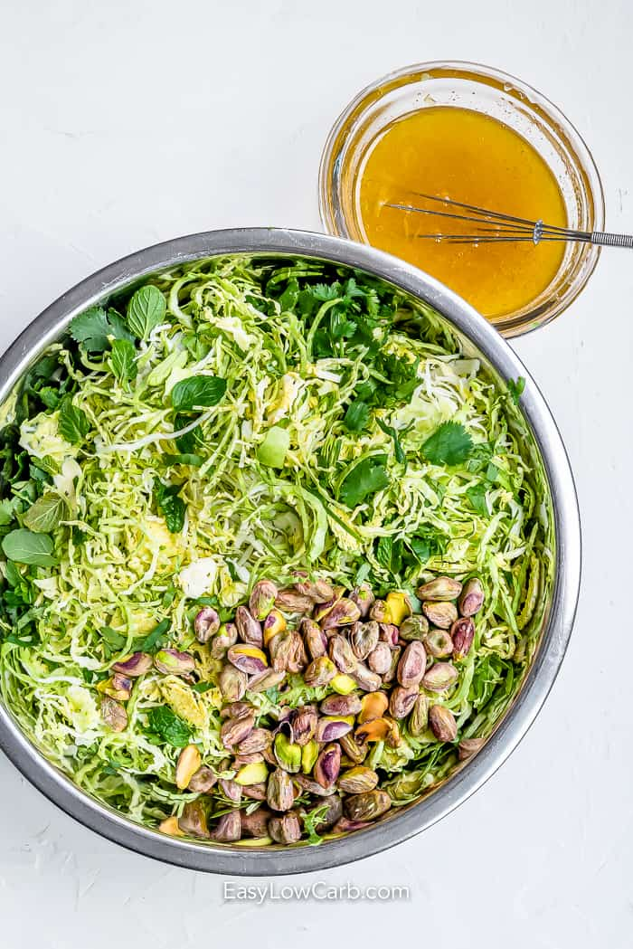 ingredients assembled for shredded brussel sprout slaw in a bowl