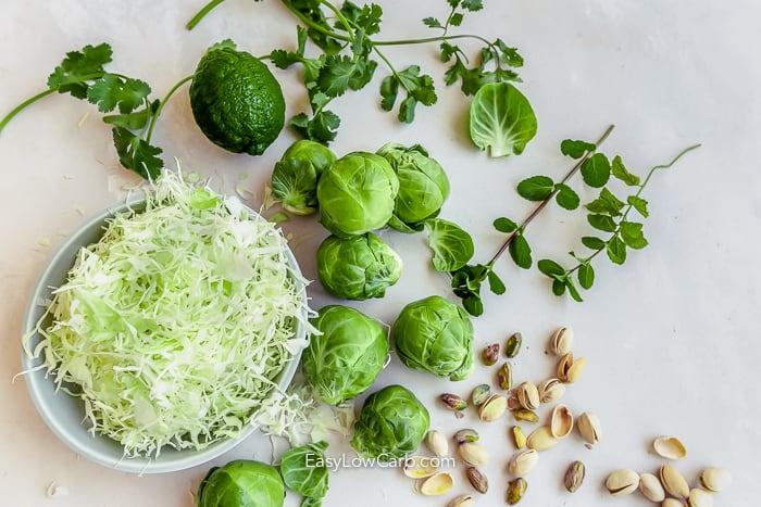 ingredients assembled for shredded brussel sprout slaw