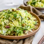 shredded brussel sprout slaw in a brown dish