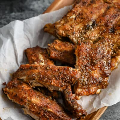 cooked ribs on a wood dish