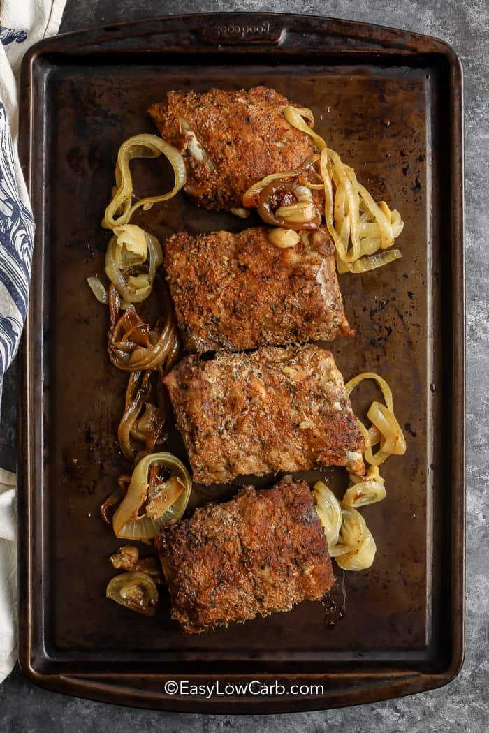 Oven Baked Ribs on a baking sheet with onions