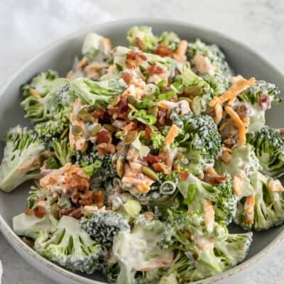 broccoli bacon cheese salad in a grey bowl
