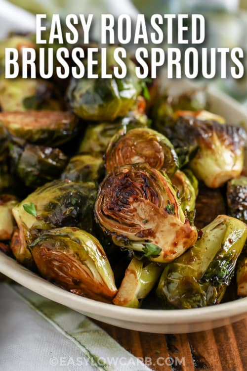Roasted Brussels Sprouts on a plate with writing