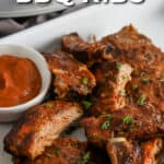 Crock Pot BBQ Ribs on a serving tray with sauce with text