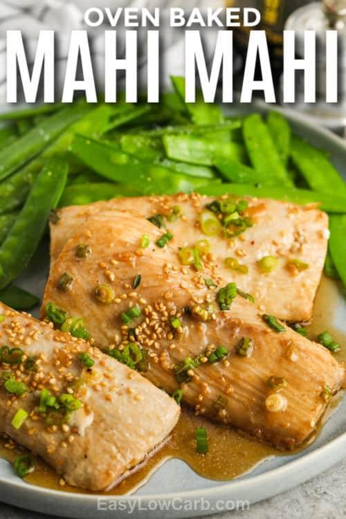 Baked Mahi Mahi on a plate with writing