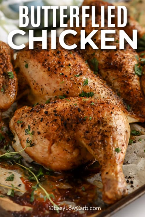 cooked Butterflied Chicken on a pan with text