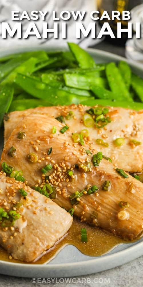 plated Baked Mahi Mahi with peas and a title