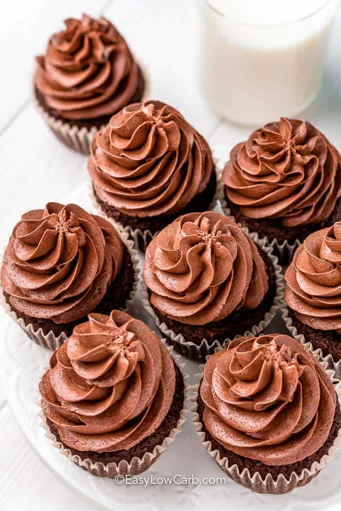 top view of chocolate cupcakes with glass of milk