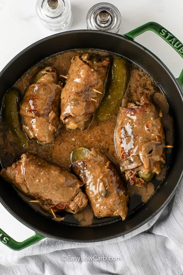 Beef Rouladen in a frying pan with gravy