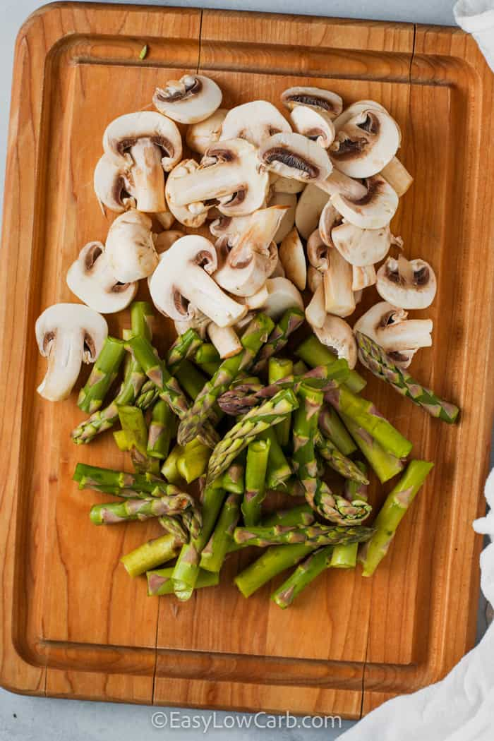 mushrooms and asparagus on a cutting board to make Sautéed Asparagus and Mushrooms
