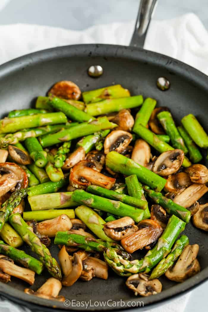 close up of Sautéed Asparagus and Mushrooms in the pan