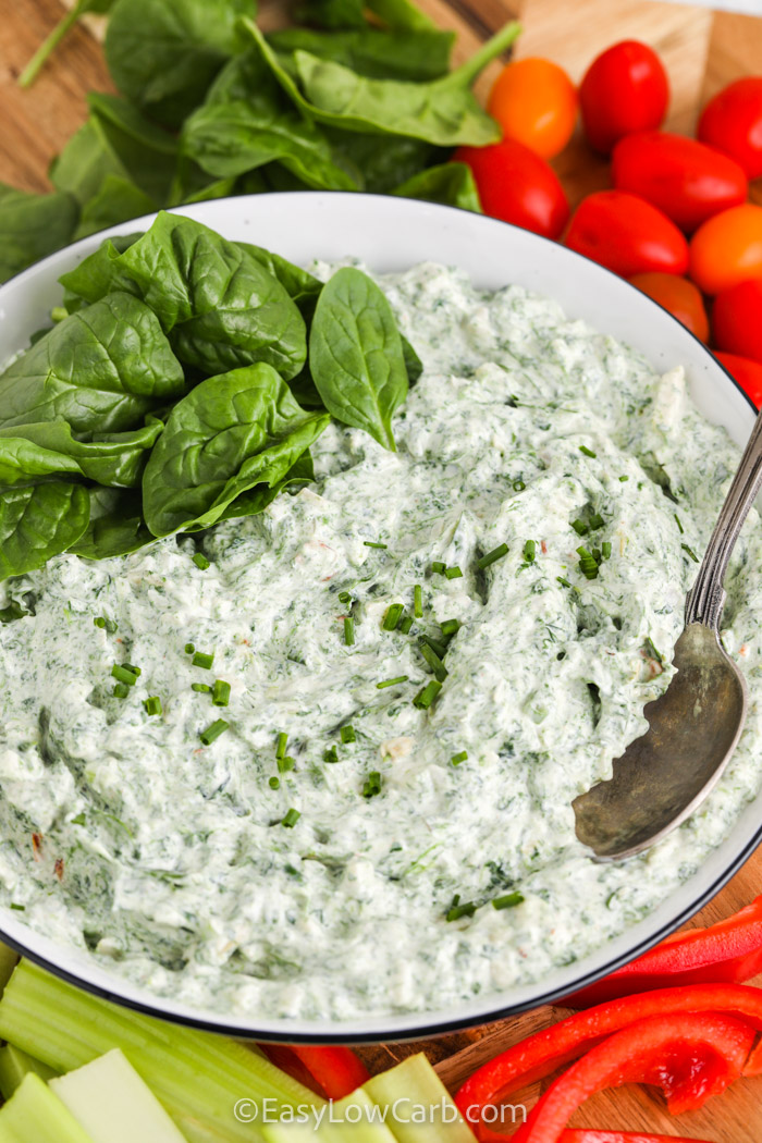 close up of Easy Spinach Dip in a bowl with a spoon